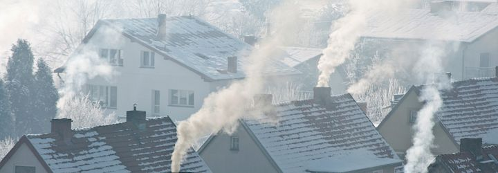 Soot arising from chimneys in residential area
